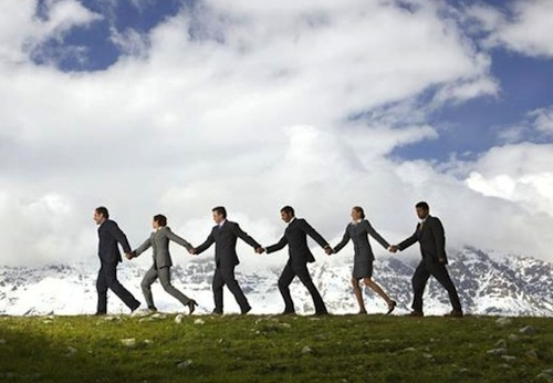 business_people_holding_hands1